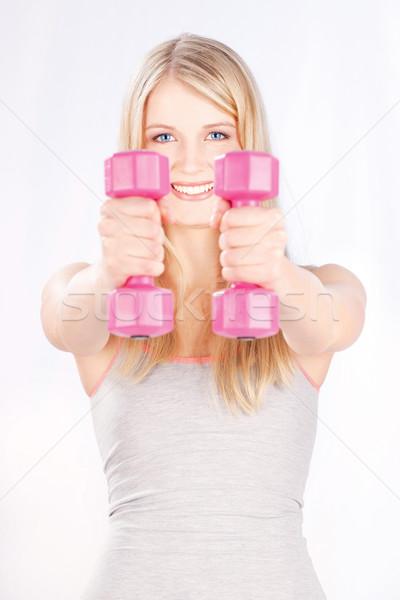 Fitness jonge vrouw twee gewichten mode lichaam Stockfoto © imarin