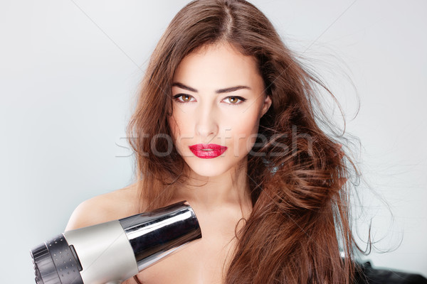woman with long hair holding blow dryer Stock photo © imarin