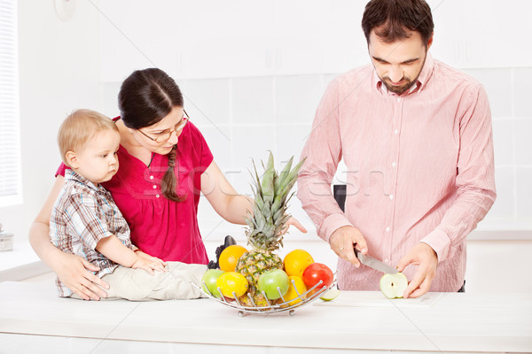 Father is preparing fruit for child  Stock photo © imarin