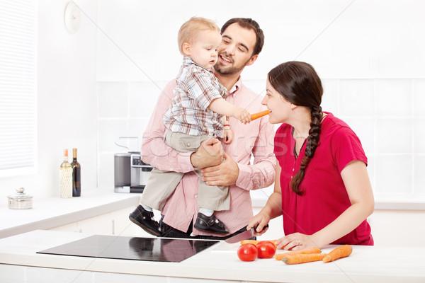 Család ételt készít konyha boldog család mosoly gyermek Stock fotó © imarin