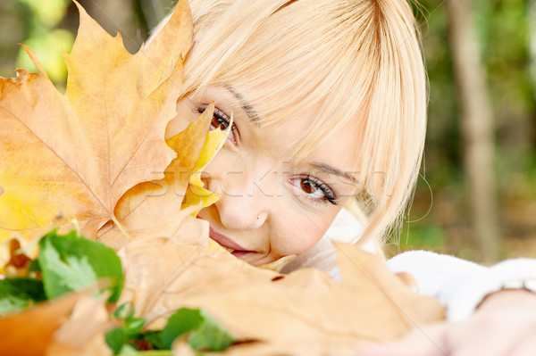 young blonde behind the leaves Stock photo © imarin