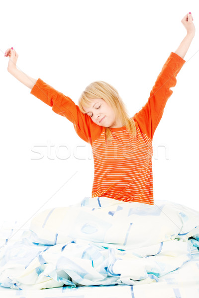 woman stretched arms in bad Stock photo © imarin