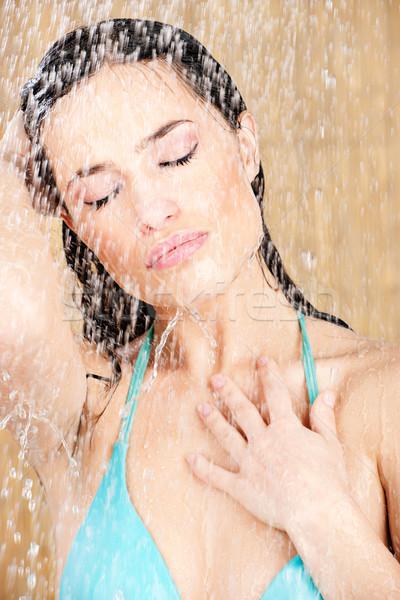 Pretty sensual woman having a shower Stock photo © imarin