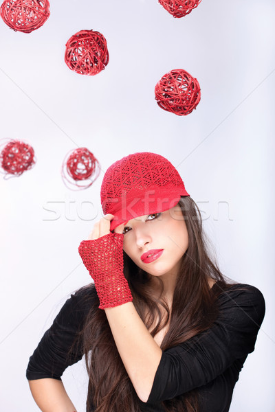 woman with red hat between red balls Stock photo © imarin