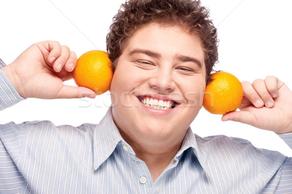 Chubby boy and orange Stock photo © imarin