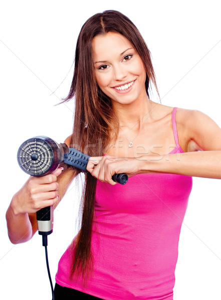 woman holding blow dryer and comb Stock photo © imarin