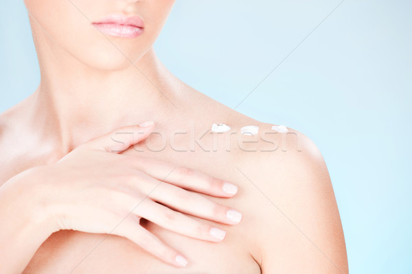 cosmetic cream on woman's shoulder Stock photo © imarin