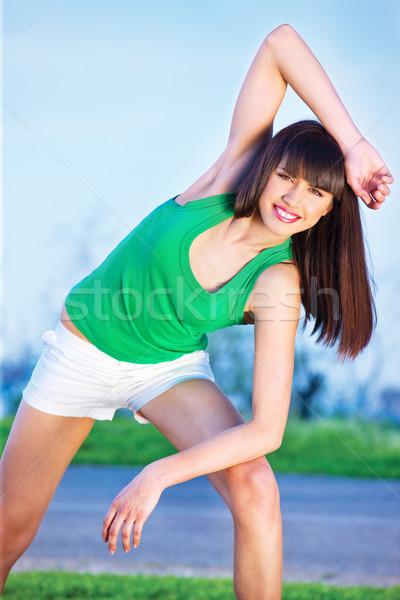 woman doing exercise outdoors Stock photo © imarin