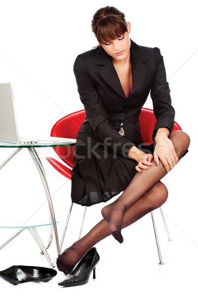 business woman relaxing her leg with massage  Stock photo © imarin