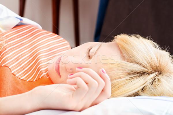 sleeping with hand on pillow Stock photo © imarin