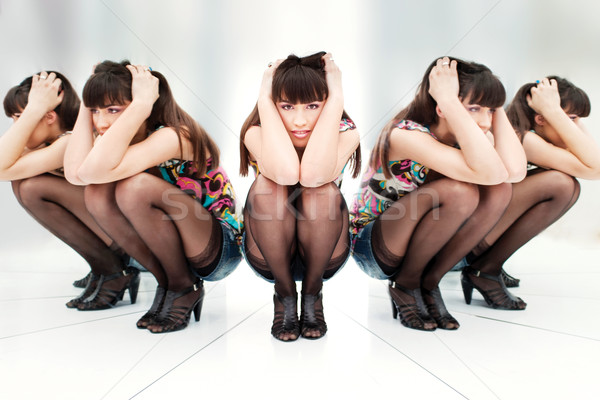 Stock photo: woman between two mirrors