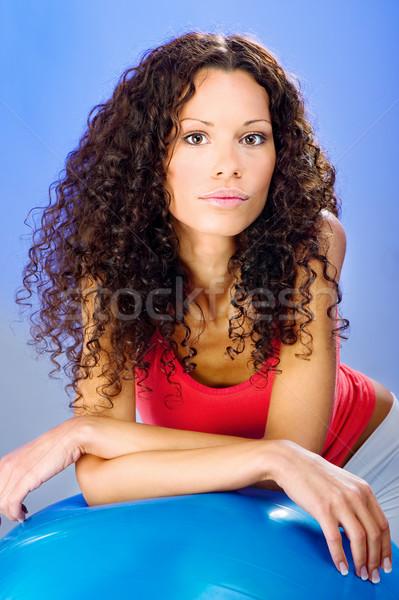 pretty curls hair women on blue pilates ball Stock photo © imarin