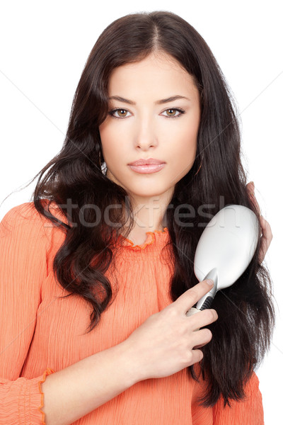 pretty woman combing her long black hair Stock photo © imarin