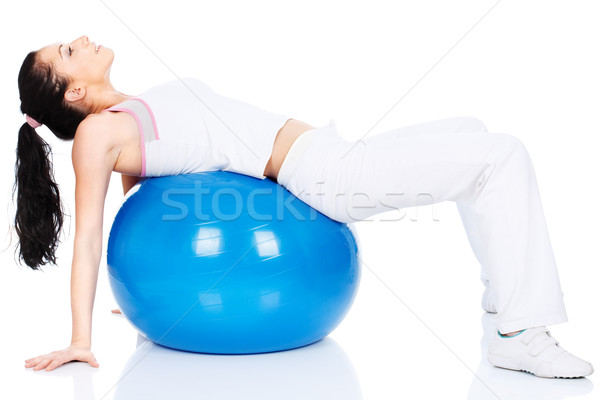 Woman lying on back on the pilates ball Stock photo © imarin