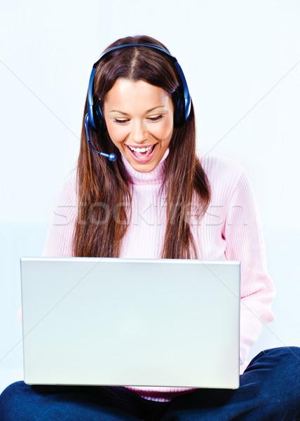 Technológia otthon boldog fiatal nő fejhallgató laptop Stock fotó © imarin