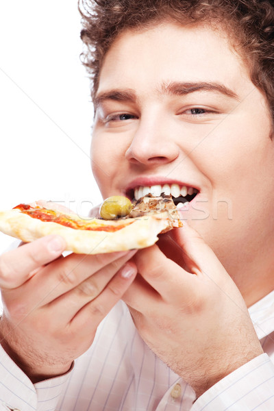 chubby boy eating a slice of pizza Stock photo © imarin