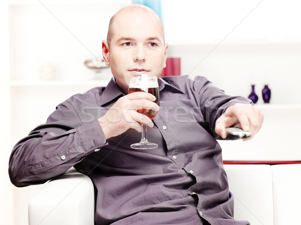 Stock photo: man relaxing at home with beer