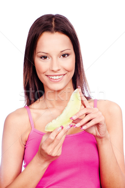 woman holding slice of yellow melon Stock photo © imarin