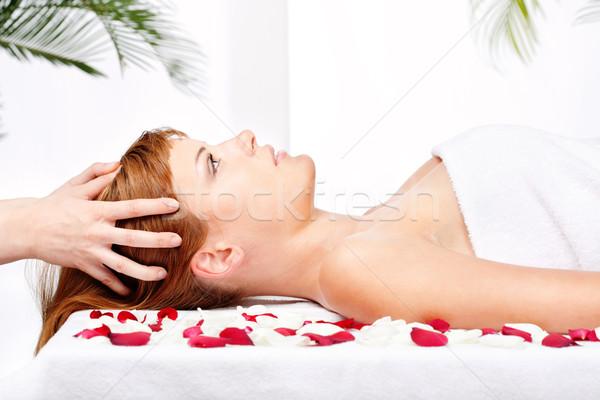 woman on head massage treatment in salon Stock photo © imarin