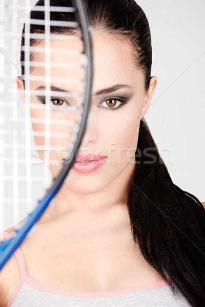 Güzel kadın tenis raketi arkasında eğlence genç kadın Stok fotoğraf © imarin