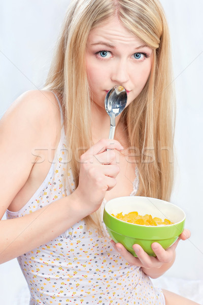 woman holding spoon and corn flakes Stock photo © imarin