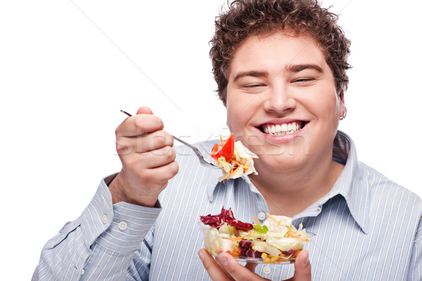 chubby man with fresh salad Stock photo © imarin