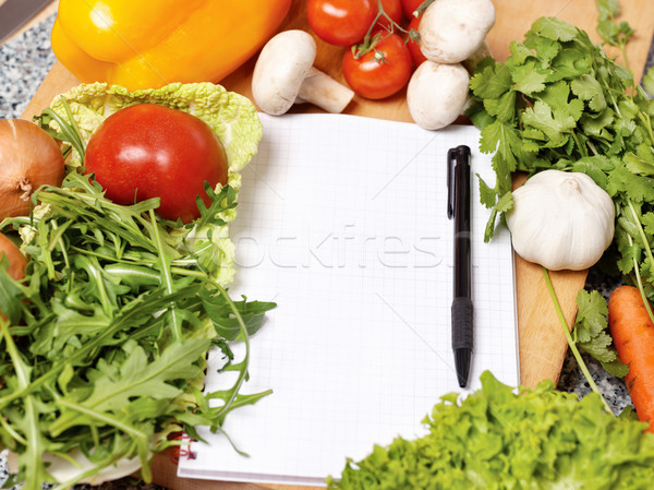 Stock photo: Note book among the vegetables
