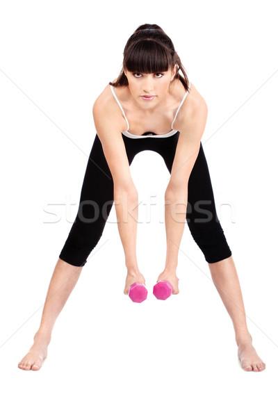 Fitnessz fiatal nő kettő súlyok izolált fehér Stock fotó © imarin