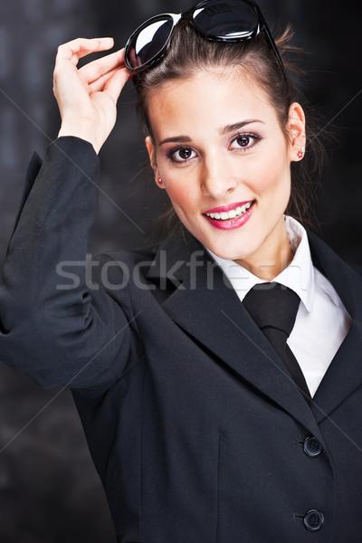 woman with sun glasses on dark background Stock photo © imarin