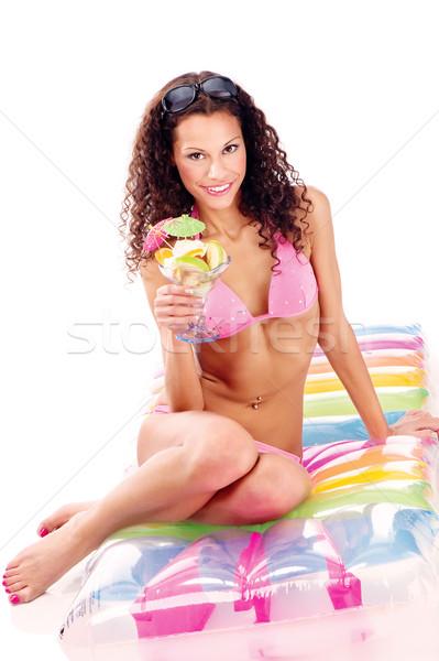 Femme air matelas tasse fruits Photo stock © imarin