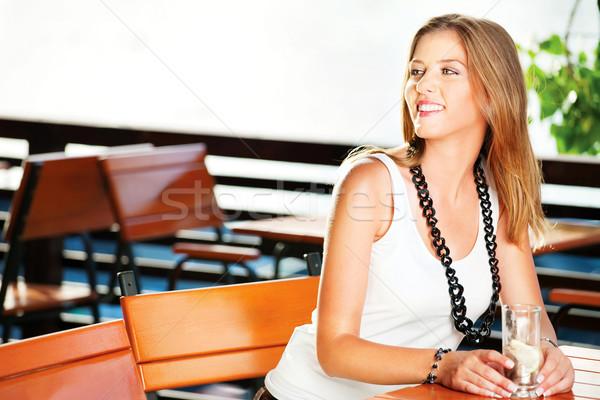 Pretty woman near river Stock photo © imarin