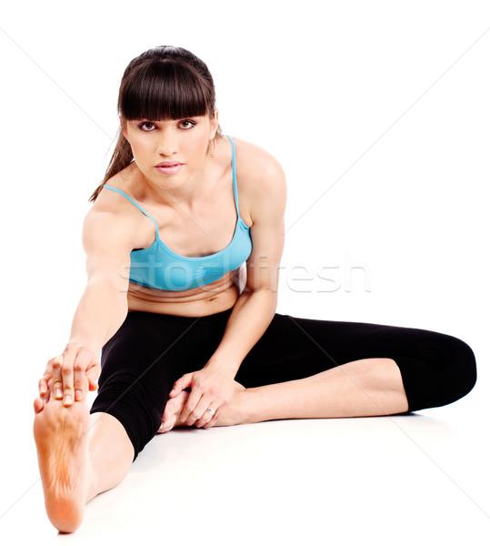 Nő fitnessz testmozgás izolált fehér munka Stock fotó © imarin