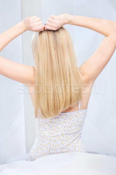 woman stretching arms above head in bedroom Stock photo © imarin