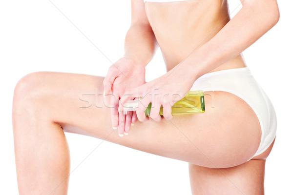 Been cosmetische benen behandeling geïsoleerd witte Stockfoto © imarin