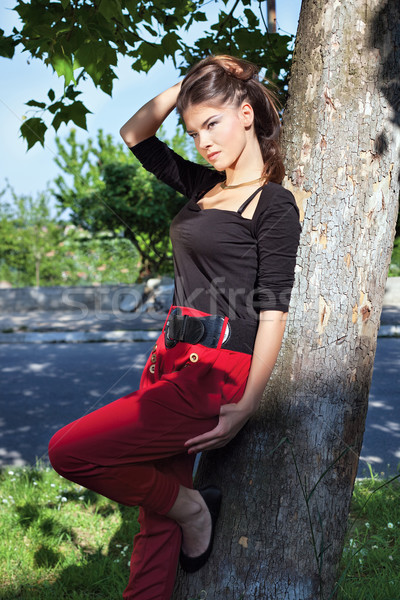 Pretty woman on sunny day in park Stock photo © imarin