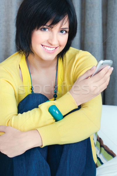 Stock photo: girl using mobile phone at home