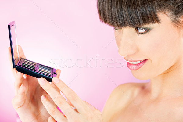 woman checking face skin in mirror Stock photo © imarin