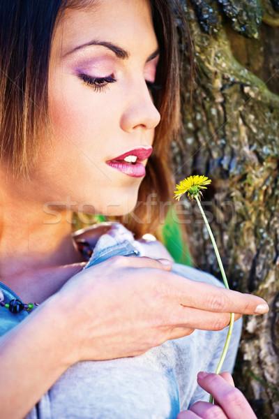 woman holding yellow flower Stock photo © imarin