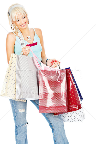 Bags and credit card in her hands Stock photo © imarin