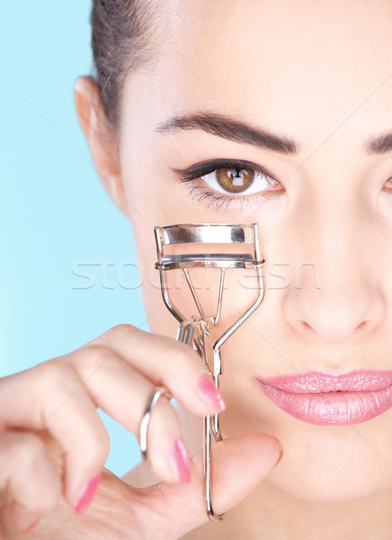 Pretty woman holding tool for eyelash Stock photo © imarin