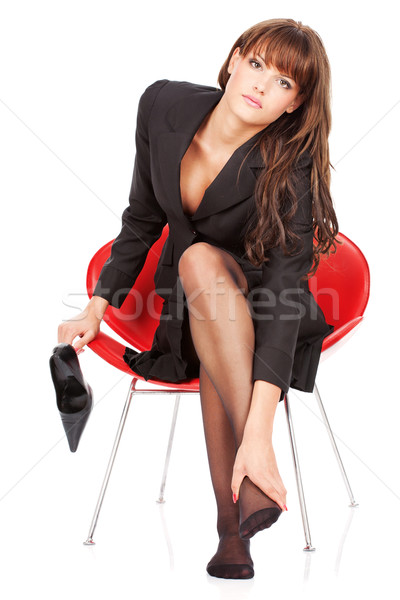 Stock photo: Woman give herself foot massage
