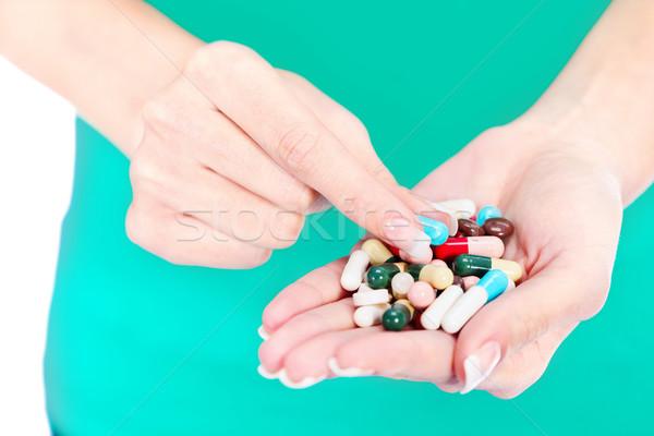 capsules in woman's hand Stock photo © imarin