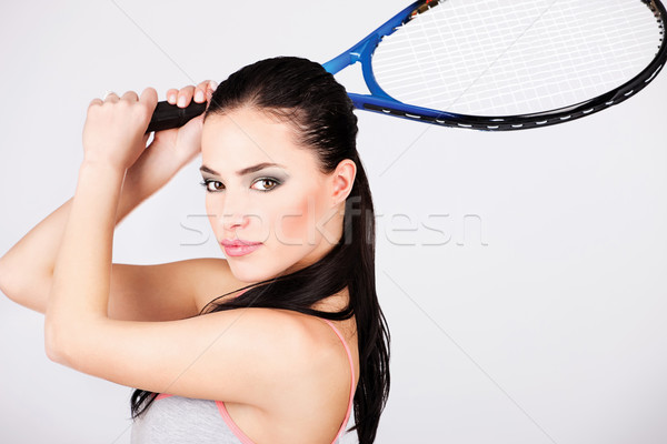 Stock photo: Pretty woman with tennis racket