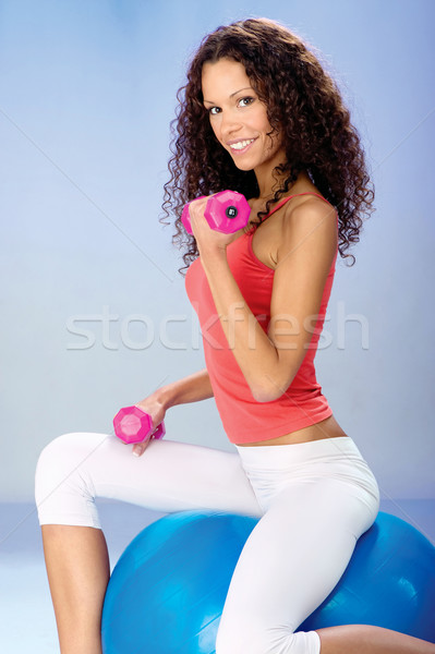 weight exercise on the big blue ball Stock photo © imarin