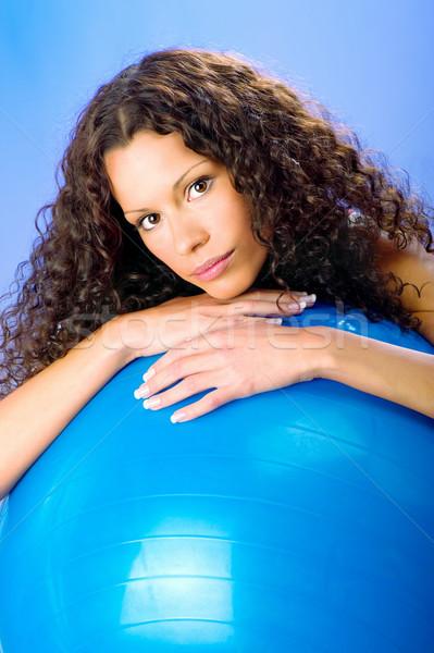 curls hair women on blue pilates ball Stock photo © imarin