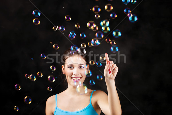 Happy girl and soap bubbles Stock photo © imarin