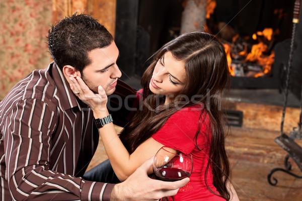 woman caress her man near fireplace Stock photo © imarin