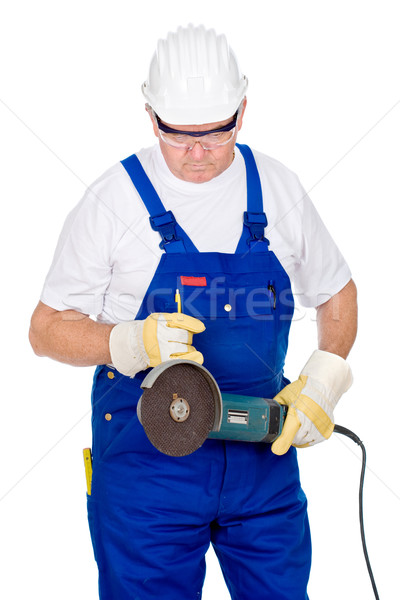 Middle age man in worker suite holding surface grinding machine Stock photo © imarin