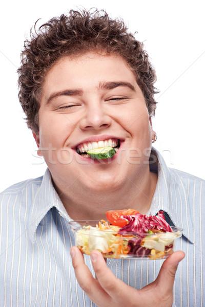 chubby man with fresh salad Stock photo © imarin