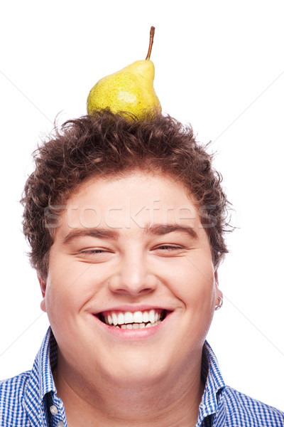 Chubby boy and pear Stock photo © imarin